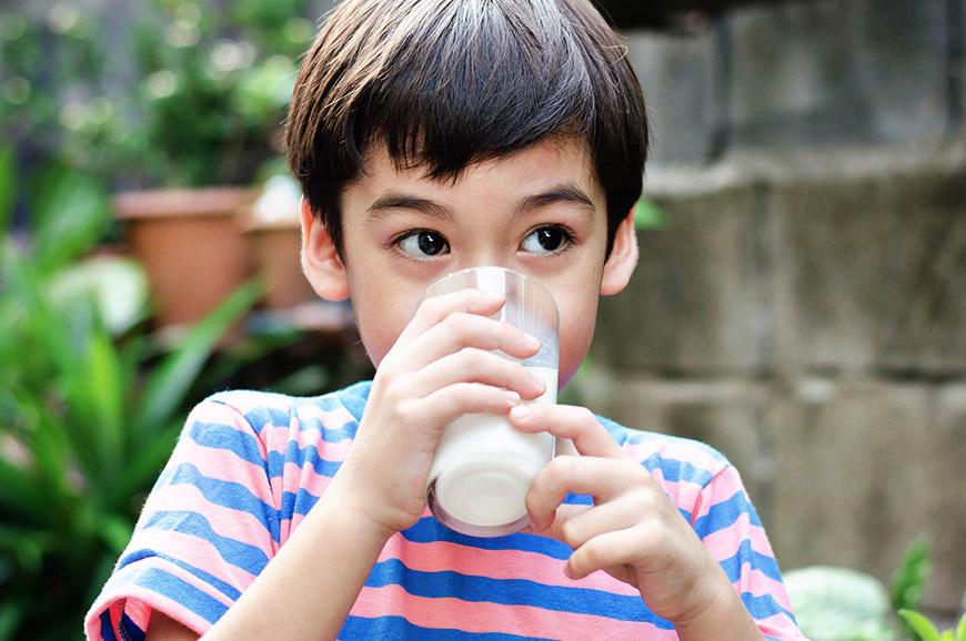 little boy enjoying the nutrients in milk