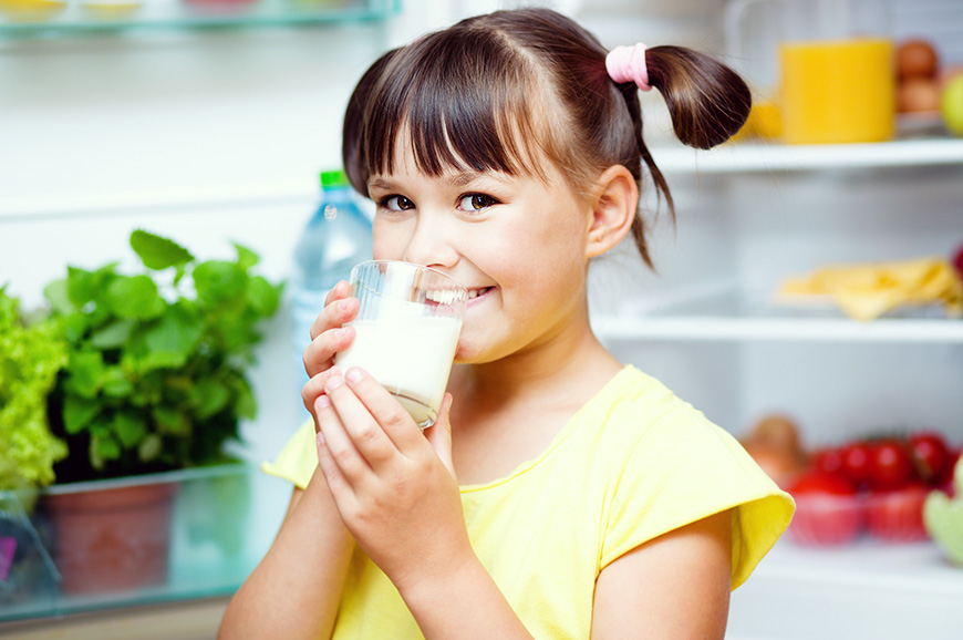 cute little girl drinking California Milk
